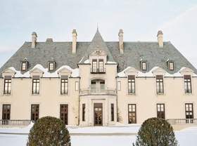 castle wedding location in huntington, new york oheka castle exterior in winter snow on ground