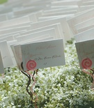 White escort card with pink lettering