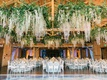 wooden beams, ceiling installations with greenery and garlands of orchids & crystals
