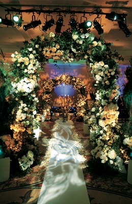 Ceremony inspired by French garden with flower arch