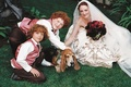 Bride and two ring bearers pet dog ring bearer