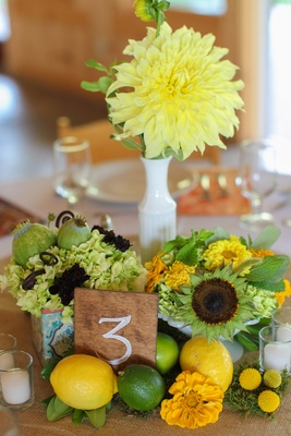 Lemons and limes with flowers for wedding centerpiece