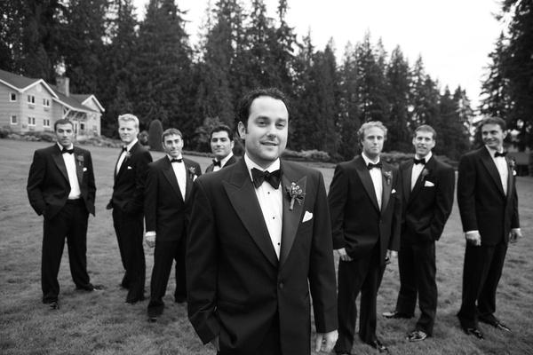 groom and groomsmen in field