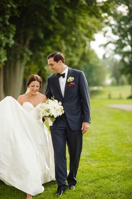 Bride in strapless Legends Romona Keveza wedding dress sweetheart neckline groom in suit tuxedo