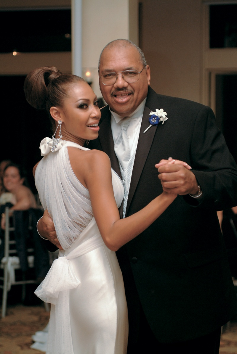 Father and daughter dancing at reception