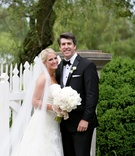 smiling bride and groom, strapless Vera Wang wedding gown, black-and-white suit