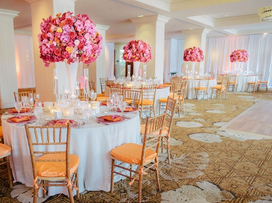 Round guest tables situated on golden carpet