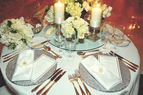Ivory flowers and candles on white table