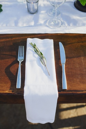 Rustic wedding place setting with green sprig