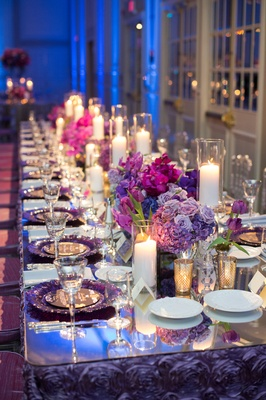 purple linens, purple chargers, candles, lavender roses, purple hydrangeas, orchids