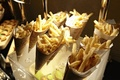 Paper cones in Lucite tray filled with French fries