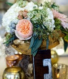 Fall wedding with gold branch vessel, pink garden rose, white hydrangea flower arrangement