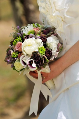 Wedding bouquet with peony, mum, calla lily flowers