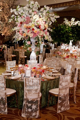 Green tablecloths with colorful floral arrangements