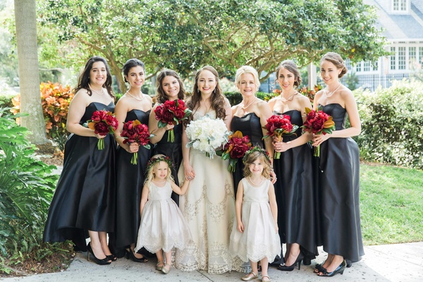 bride bridesmaids flower girls ladies of bridal party black dresses white red bouquets wedding