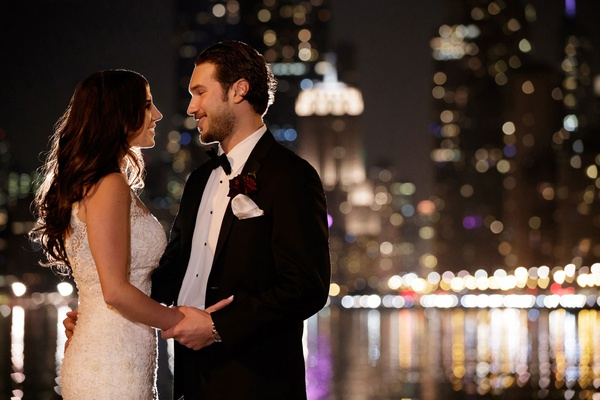 bride and groom looking into each other's eyes in chicago night shot by bob dawn davis photography