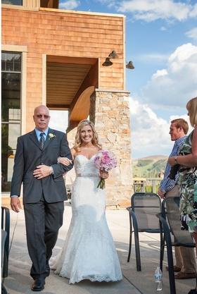Bride walking down aisle at mountain lodge in Big Sky, Montana
