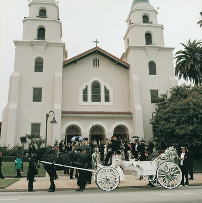 Horse drawn carriage wedding transportation from church