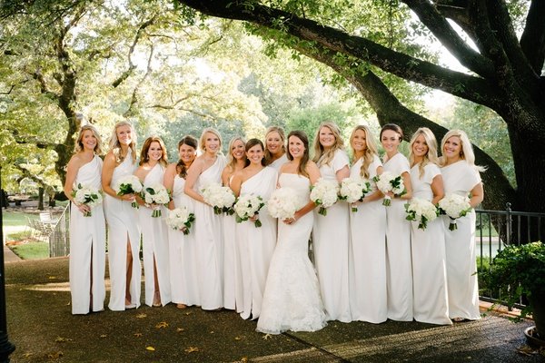 bride in lace vera wang, bridesmaids in white lela rose dresses