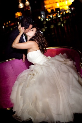 Bride kisses groom at Beverly Hills hotel wedding