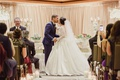 Traditional wedding ceremony bride in ball gown pnina tornai kiss chairs guests taking photos