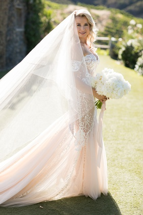 bride in pallas couture with large two layered cathedral veil