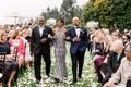 shane vereen nfl player with mom and dad at wedding ceremony grass lawn flower petals groom in navy