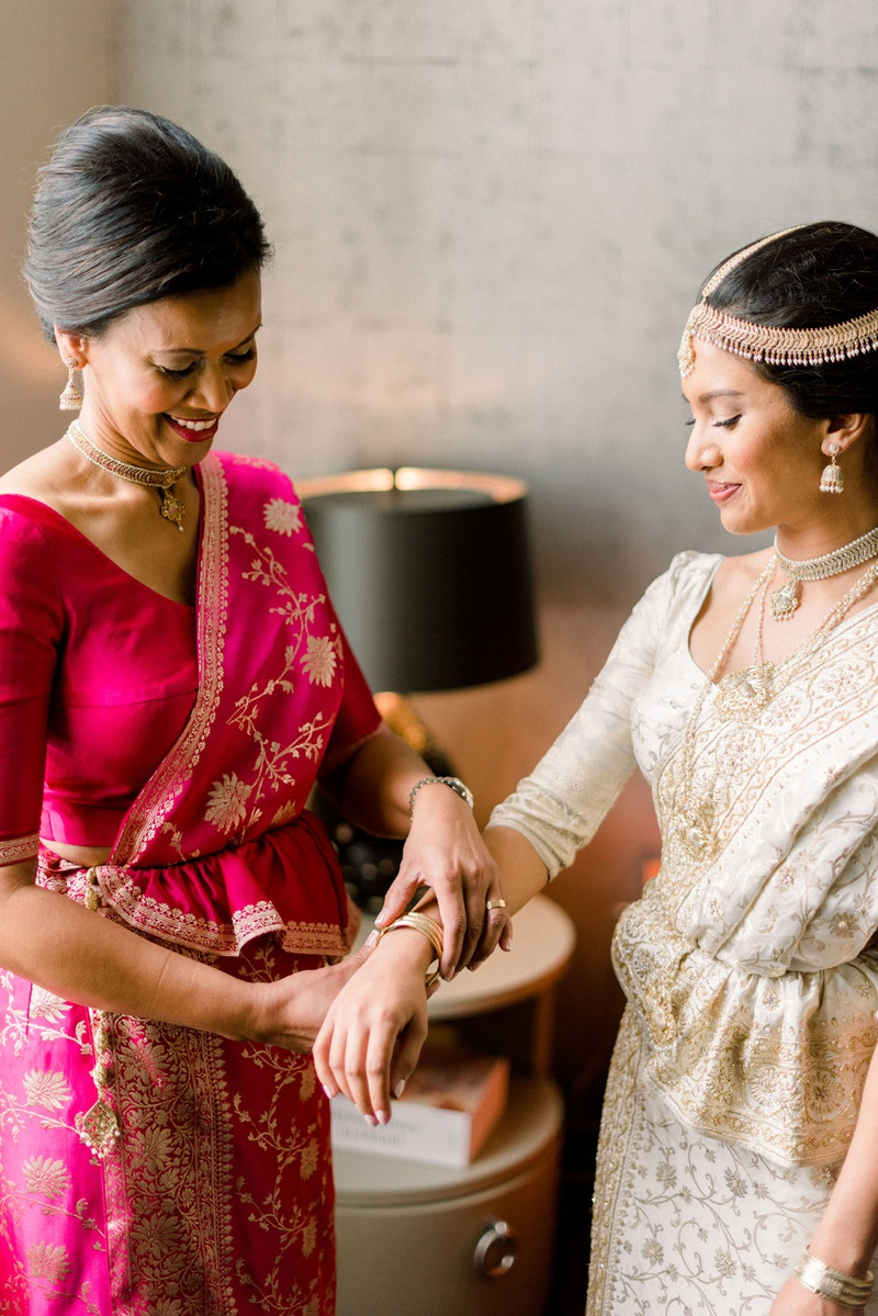 sri lankan bride with mother getting ready for wedding day, mother of the bride in fuchsia sari