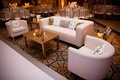 Couch and chairs next to white dance floor