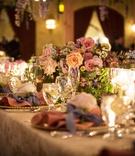 Wedding reception flower print linens gold charger pink napkin blue ribbon rose flower pink blooms