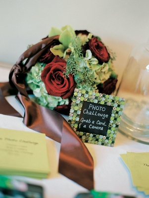 Green photograph challenge cards for wedding guests to play reception game