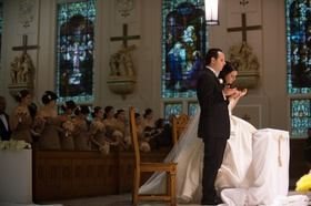 Bride and groom at church altar for white wedding