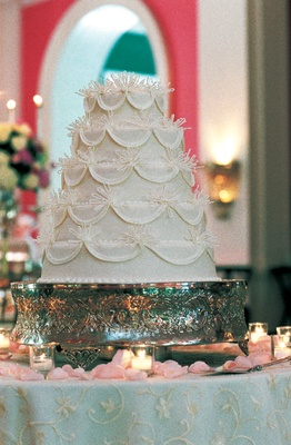 Five layer cake on ornate silver stand