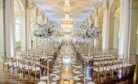 White, gold, and silver wedding ceremony decorations in Atlanta