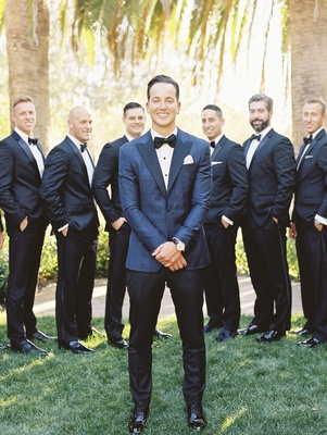 groom in blue windowpane suit jacket with black trousers, groomsmen in black