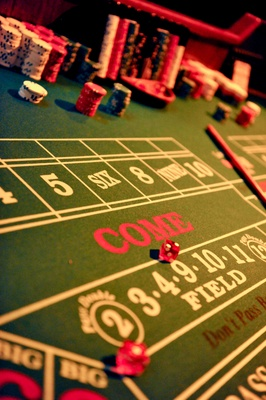 Red dice on green felt Casino game table