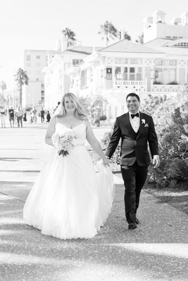 black and white photo of a bride and groom holding hands wedding portrait santa monica casa del mar