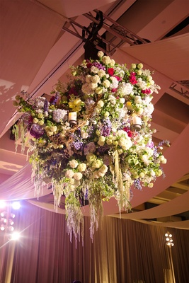Candle chandelier decorated with flowers and branches