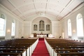 Church wedding ceremony with red center aisle