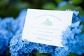Wedding stationery with reception information on blue hydrangeas