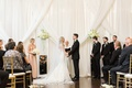 Exchanging vows in elegant decor biltmore ballrooms mirror riser drapery on wall drapes