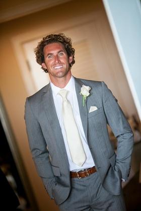 Jeffrey Barnett stunt man groom in grey pinstripe suit