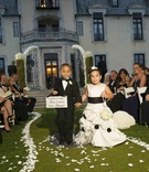 Flower girl and ring bearer holding sign at Oheka Castle