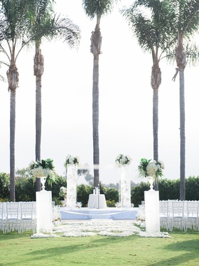 Wedding ceremony of Stephanie Ming and Levine Toilolo palm trees white decor green tropical leaves