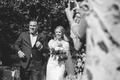 Black and white photo of emotional walk down aisle