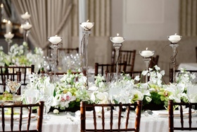 Wood chairs and branch-wrapped candlesticks