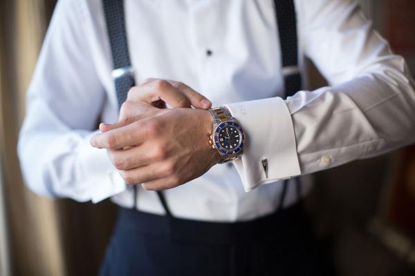 groom tightening watch cuff links and monogrammed cuffs white shirt suspenders