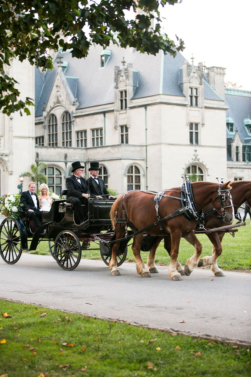 Bride and father of bride transported to wedding ceremony in horse drawn carriage with men top hats
