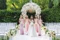 bride in off shoulder galia lahav wedding dress bridesmaids in light pink dresses off shoulder strap