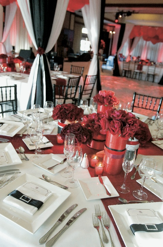 Classic wedding reception decorations in black, red, and white